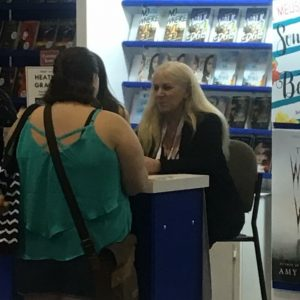 My husband snapped a picture when he caught me at the Harlequin booth. (Me meeting Heather Graham)